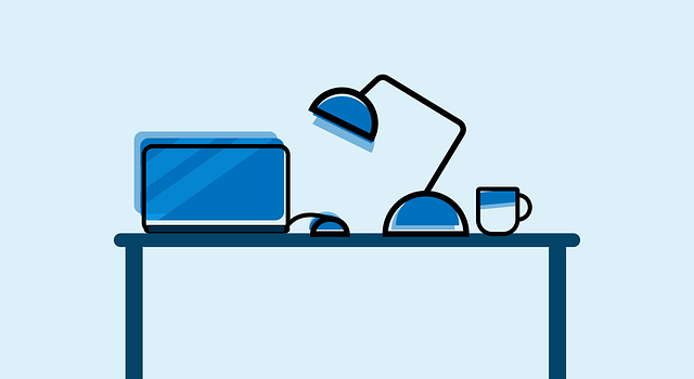 cartoon in blue of a desk with a laptop, mouse, lamp, and mug